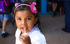 Captured this sweet moment amidst the chaos of Monday classes in a Nicaraguan elementary schoolyard. I used to always eat lollipops in school. Have to say this girl is really onto something!  by cultivatingcuriosity