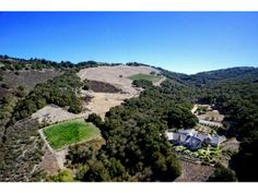 11709 Camino Escondido Rd, Carmel Valley, CA 93924 — Privacy, comfort and casual style is what comes to mind when I think of the home at 11709 Camino Escondido Rd.  Built new in 2005, this 10 acre estate has a roomy 4548 square foot, 4 bedroom, 3.5 bath home on it. With a combination of large planked hardwood and travertine stone floors, soaring open beam ceilings and a large open floor plan make this house easy to live in.