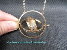 the Hermione Granger time turner necklace the harry potter jewelry steampunk vintage style gift idea on Etsy, $12.98