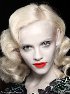 The Popular Veronica Lake Hairstyle of the 1940s     & Retro Red Lipstick  are Trendy !    Anna Sui Spring-Summer 2012.