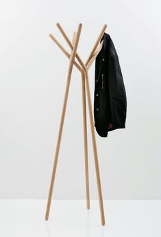 greek designer yiannis ghikas has created the tri-foot coat hanger 'game of trust. Tree Designs, Cool Designs, Hanger Game, Coat Hanger Stand, Clothes Stand, Spa Design, Rack Design, Coat Stands, Cabin Interiors