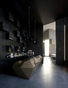 The entrance to the bar is the filter access to the dining rooms and the dark colour that characterizes it makes the transition more evocative. The wall of the bar is covered with lacquered panels with luminous inserts, while the counter is made of lacquered fiberglass with bronze metallic paint.: