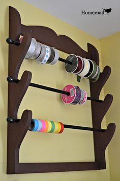 used an old gunrack, added some curtain rods for dowels, and voila!.... ribbon / washi tape rack!