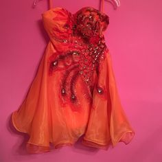 Party dress Super cute custom made orange dress worn once! It has built in support and is great for a sweet sixteen, prom, or any other type of formal/ semi formal event Dresses Strapless
