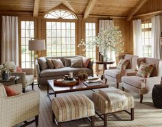 Pinned for furniture arrangement - allows for lots of seating for friends and family. Stylish Living Room Featuring Nate Berkus Fabrics
