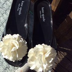 Kate Spade Jellies Summer is coming!!!! Kate Spade black jellies with a flower embellishment. Super cute with shorts or Capris.  These shoes have a thong front.....not a slide. Smoke free home. kate spade Shoes