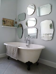 to hang a display of vintage mirrors frameless-mirror-wall-display. Also loving the soft grey and roll top bath with little shelf at the endframeless-mirror-wall-display. Also loving the soft grey and roll top bath with little shelf at the end Old Mirrors, Vintage Mirrors, Vintage Bathrooms, Chic Bathrooms, Framed Mirrors, Mirror Collage, Small Mirrors, 1930s Mirrors, Shabby Chic Bathrooms