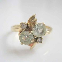 This yellow flower ring with pale green fluorite. | 65 Impossibly Beautiful Alternative Engagement Rings You'll Want To Say Yes To