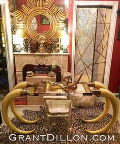 Vintage Faux Elephant Tusk Table with Lucite top and Brass and Chrome Facets Designed by Suzanne Dahl and Jerry Barich Circa 1977...Not For Sale, I need to savor.  #Suzannedahl #jerrybarich #tusktable #fauxelephanttusk #dynastyalexisdesk #1980sdecorating #grantdilloncom #losangelesvintagefurniture  #karlspringer