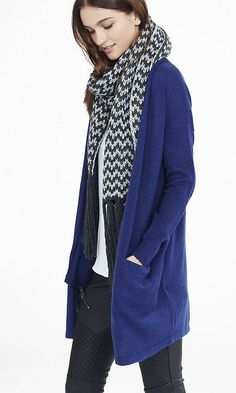 Cozy up to this extra-long chevron stripe knit scarf. It's long enough to circle around your neck once or twice on those extra-chilly days.