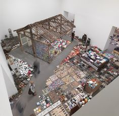 """Song Dong's """"Waste Not"""": an art installation originally in China but recreated here in Vancouver. It contains the frame of his mother's house and all the meticulously collected, often damaged objects she filled it with."""