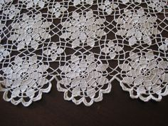 Antique ecru Crochet Lace Tablecloth...I have two of these made by my great grandmother. She used them as bed coverlets.