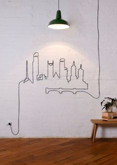 Turn that ugly extension cord into art! Use it to decorate your walls with your favorite skyline or another design!