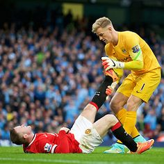 MANCHESTER, ENGLAND - Sunday, November 2, 2014: Manchester City's goalkeeper Joe Hart helps England team-mate Manchester United's Wayne Rooney during the Premier League match at the City of Manchester Stadium. (Pic by David Rawcliffe/Propaganda)