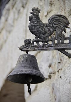 The Coq or rooster, one of the traditional, enduring symbols of France, is found everywhere in France. Standing guard over a bell, this is a bit of french country you might want to bring home.   Honfleur, the lovely French port in Normandy.
