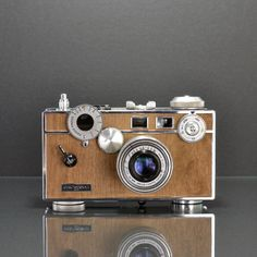 Argus C3 Mansonia Refurbished rangefinder camera hand finished with unique real wood veneer. Click for more of these gorgeous cameras