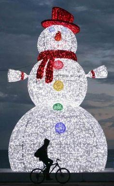 Huge snowman decoration at night