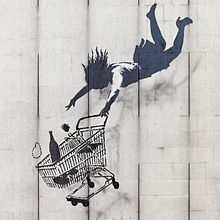 """""""Shop til you drop"""" Anti capitalism piece by Banksy graffiti artist. . Although I'm not a supporter of graffiti, I have to wonder if Banksy isn't more than that. I love that he challenges what 'normal' people accept via the media, etc. . I guess I like that he makes people think!"""