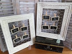 Vintage frames, painted, distressed and backed with chicken wire.  Clothespins with tiny chalkboards added to hang photos/memos.