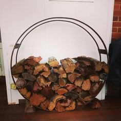 Firewood rack made from antique steel buggy rims. #perennialle #perennialleplants #Canowindra #morethanyouexpect #firewood #upcycled