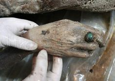 A 700-year-old mummy was found by chance by Chinese road workers. She was wearing silk and cotton and is believed to be a high-ranking member of the Ming Dynasty. A beautiful ring also adorned her finger.