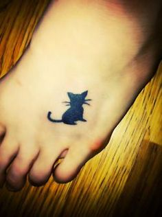 Looking for a great cat tattoo for Kitty and adding her paw print.