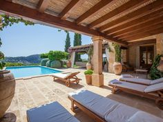 Villa in natural stone country house style in Camp de Mar with beautiful terrace and pergola.
