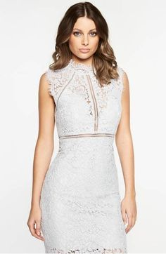 Ladder stitching draws the eye to the high neck and tailored bodice of an elegant lace sheath dress with delicate eyelash edges.