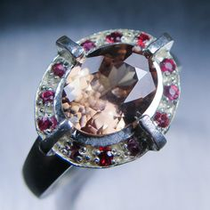 2.75cts Natural Zircon pink cream brown 9.44x7.56mm & red by EVGAD