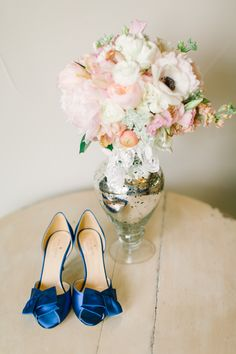 Blue shoes and blooms | Read More: http://www.stylemepretty.com/2014/08/22/sweet-southern-pecan-springs-ranch-wedding/ | Photography: My Mint Photography - mymintphotography.com/