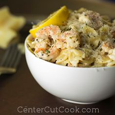 Tender shrimp and pasta get tossed together in scampi sauce with garlic and parmesan!