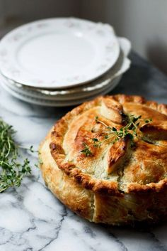 A vegan Spring Vegetable Pot Pie bridges the seasons by utilizing the new vegetables of Spring, in a warm and comforting way. Easy and adaptable | http://www.feastingathome.com