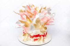 A wedding cake. Festive white cake with butterflies - Stock Photo ,