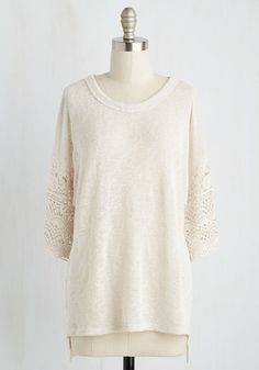 Pair your alluring personality with this cream top, and you'll find yourself surrounded by the most charming of characters! Your new pals will be drawn in by the unique sections of crocheted lace that trim the 3/4-sleeves of this knit piece, and you'll be loving every moment in the limelight!