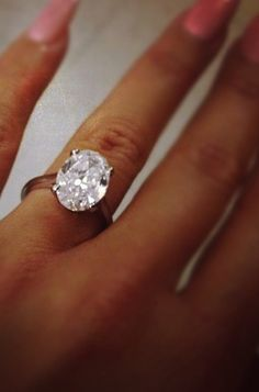 Which recently married star wears this stunning oval cut diamond engagement ring?