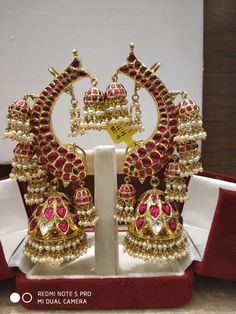 Beautiful gold ear rings with jumkhi hangigns. Earrings studded with rubies. 30 December 2018