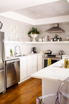 White kitchen with open shelves and gold accents