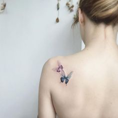 Butterflies on back shoulder by Tattooist Flower
