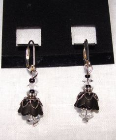 Silver flower drop earrings by amojeweler on Etsy. They have red, silver and black. Super cute!