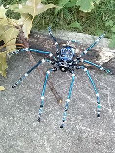 Hey, I found this really awesome Etsy listing at http://www.etsy.com/listing/163664817/beaded-spider-lampwork-suncatcher