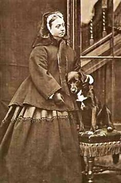 Queen Victoria in deep mourning, with her dog Sharp.  The death of Prince Albert left her shattered.