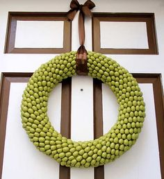 DIY fall wreath--painted acorn wreath from painted acorns.  This page has 30 fall wreaths to make. Awesome!!  http://www.addicted2decorating.com/diy-fall-wreath-roundup.html