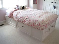 DIY bed with drawers - instructions included:)  Minus all the flowers and pink.