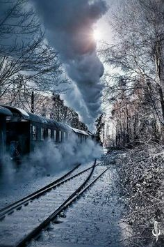 Trains that were the old black locomotives belching out their billows of smoke and leaving long trails to mark their pathway.