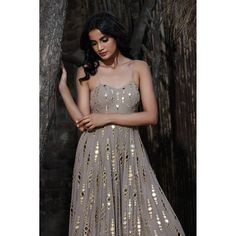 The taupe dainty mirror gradation kalidar ensemble defines perfection. A classic silhouette which is feminine, classy and fun is paired… Party Wear Indian Dresses, Designer Party Wear Dresses, Indian Gowns Dresses, Indian Bridal Outfits, Indian Fashion Dresses, Kurti Designs Party Wear, Dress Indian Style, Indian Designer Outfits, Ethnic Dress