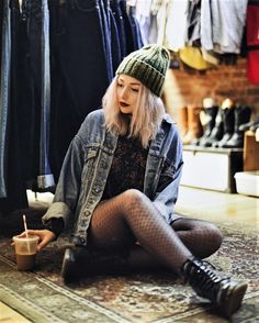 Green beanie hat, choker necklace, denim jacket, floral sweatshirt, fishnet stockings & combat boots by nicolealyseee
