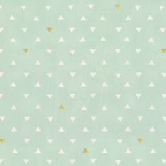 Mint and Gold Triangles Fabric by the Yard | Carousel Designs.  These great little triangles are scattered along the soft mint background with a splattering of gold. Printed on a soft quilting weight cotton this lovely fabric is perfect for your crib bedding.