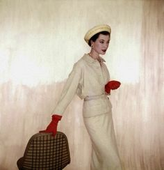 model barbara mullen wearing beige suit and blouse of wool and rabbits hair by larry aldrich Vogue 1953. photo by Clifford Coffin.