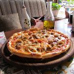 """Pizza with seafood in the """"Opera Grill"""""""