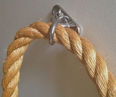 """DIY rope handrail; hardware is reportedly from """"wall brackets"""" and shackles from marine hardware store"""